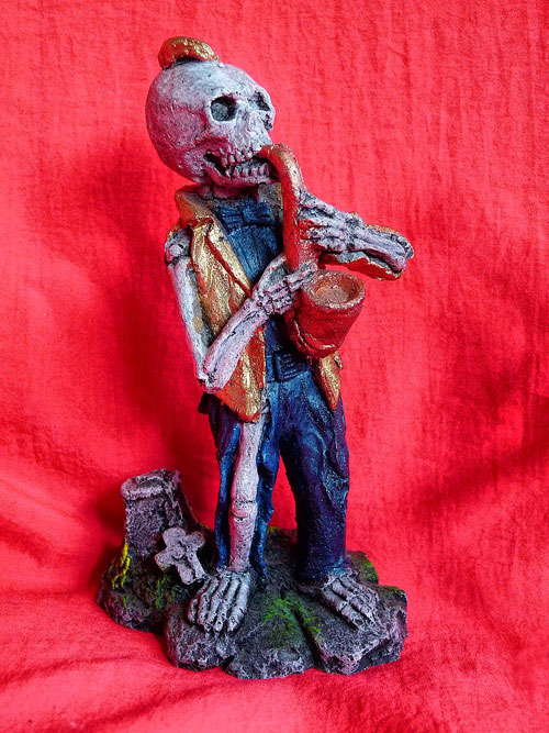 skeleton saxophone player, aquarium figurine, flexibility in teaching styles, adapting your teaching style to your student