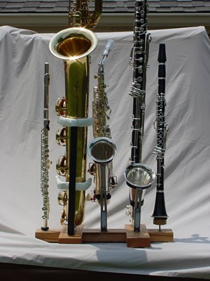 the ultimate woodwind doubler's stand, baritone sax stand, alto sax stand, bass clarinet stand, clarinet stand, flute stand